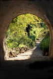 Garden. The secret garden - landscaping. Old stone bridge and stairs Stock Photos