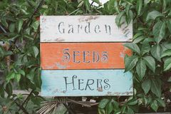 Garden, seeds and herbs wooden board Royalty Free Stock Images