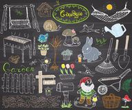 Garden set doodles elements. Hand drawn sketch with gardening tools, flovers and plants, garden figures, gnome mushrooms, rabbit, Stock Photo