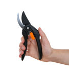 Garden shears in the hands. Of the gardener. isolation Royalty Free Stock Photo