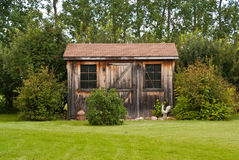 Garden shed. A charming, rustic garden shed made from reclaimed timber (barn board Stock Photos