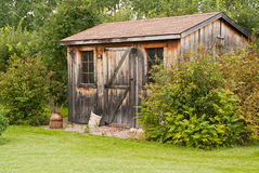 Garden shed. A charming, rustic garden shed made from reclaimed timber (barn board Royalty Free Stock Photography