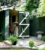 Garden Shed. In England with Gardening implements Royalty Free Stock Photography