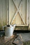 Garden Shed. The door to an old garden shed with a watering can sitting outside Stock Image
