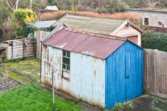 Garden shed. A rusty metal garden shed in an english home stock photos