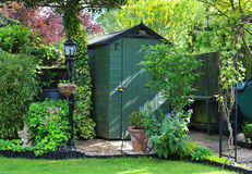 Garden Shed with log store Royalty Free Stock Image