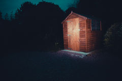 Garden shed at night. A garden shed lit up at night Royalty Free Stock Images