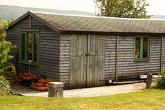 Garden shed. Photograph of a large shed in a garden Stock Photos