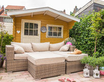 Garden shed and sofa Stock Photography