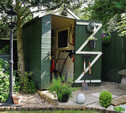 Garden Shed with Tools. English back garden Shed and paved area Royalty Free Stock Photography