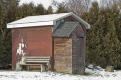 Garden shed in winter. Garden shed in trees in winter snow Royalty Free Stock Photos