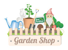 Garden shop object with shovel tree plant fertilizer watering can gnome and garden decorative statue. A Garden shop object with shovel tree plant fertilizer Royalty Free Stock Photos