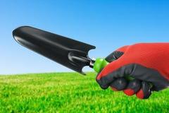 Garden shovel in hand Stock Photo