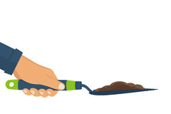 Garden shovel with soil hold in hand of gardener. Gardening, griculture, planting concept. Vector illustration flat design.Isolated on white background Stock Photos