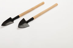 Garden shovel on a white background. Black garden spade with wooden handle lies on a white background Stock Photo