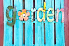 Garden Sign. Brightly coloured garden sign on planks of wood Stock Photos