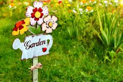 Garden sign, message on a wooden watering can Royalty Free Stock Photos