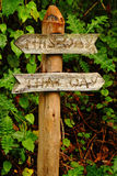 Garden Sign-This Way, That Way. A clever garden pathway sign telling you to go either This Way or That Way stock photos
