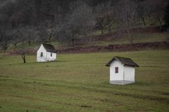Garden small houses on meadow in countryside farmland stock photography