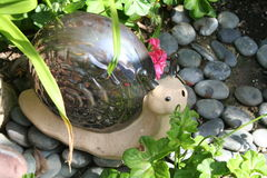 Garden Snail. Statue set on the ground Royalty Free Stock Photography