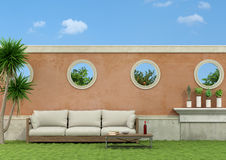 Garden with sofa Stock Photography