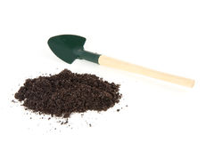 Garden soil and a  shovel Stock Images