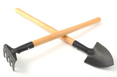 Garden spade and rake separately. On a white background Royalty Free Stock Image