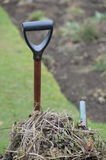 Garden spade and wheelbarrow. Royalty Free Stock Photography