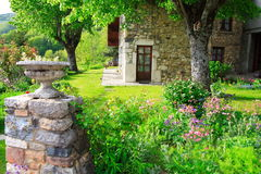 Garden at spring season. Beautiful garden in the the french countryside with an old typical house Stock Photo