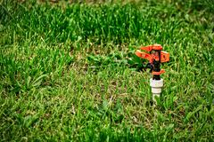 Garden sprinkler do not working state. On dying lawn stock images