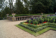 Garden stairway balustrade with urns and parterre Stock Photos