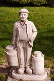 A garden statue. A farmer with two milk churns as a garden statue Royalty Free Stock Photos