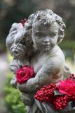 Garden Statue with Colorful Flowers Stock Images