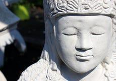Garden statue of meditating princess Stock Image