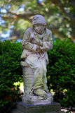 Garden Statue in Sydney Botanical Gardens. Garden statue of a boy convict in Sydney Botanical Gardens. Public art is famously scattered around the Royal Botanic Stock Photo