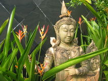 Garden Statue in Thailand. Statue with flowers Royalty Free Stock Photography