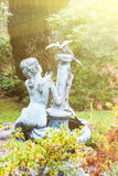 Garden statue of a woman and birds Stock Image