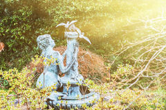 Garden statue of a woman and birds Royalty Free Stock Images