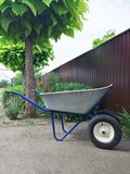Garden or steel construction on two wheels for the carriage of cargo royalty free stock images