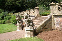 Garden steps or entrance with lion statues carrying coat of arms Royalty Free Stock Image