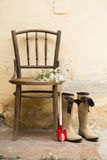 Garden still life with gum boots and garden tools Royalty Free Stock Image