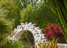 Garden with Stone Arch Stock Photo