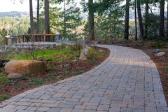 Garden Stone Brick Paver Walking Path to Backyard Deck Royalty Free Stock Photos