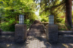 Garden Stone Columns Bench Stairs Path Hardscape. Garden path stone columns bench stairs paver bricks walkway and lamp posts in lush greenery in the park stock photos