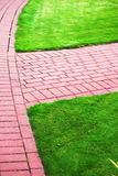 Garden stone path with grass, Brick Sidewalk Stock Photography