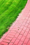 Garden stone path with grass, Brick Sidewalk Royalty Free Stock Images