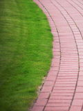 Garden stone path with grass, Brick Sidewalk Royalty Free Stock Photo