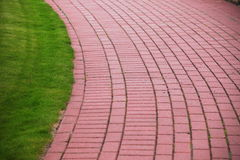 Garden stone path with grass, Brick Sidewalk Stock Image