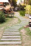 Garden stone path with grass Stock Photos