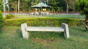 Garden Stone Skewed Seating. I found this unusual seating position in a garden/park Royalty Free Stock Photography
